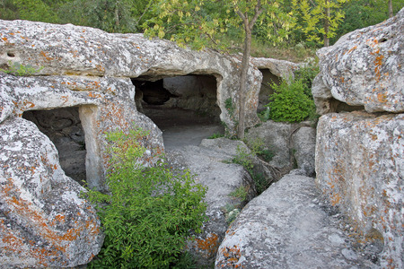 dwelling: The dwelling of the ancient people carved into the rock, a primitive civilization