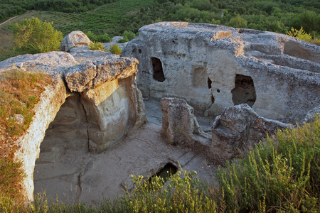 Ancient caves in which lived the first people, rocks overgrown with forest