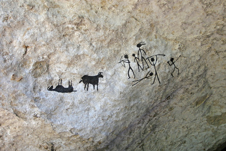 pintura rupestre: pinturas de la cueva del hombre primitivo. imitaci�n moderna de la pintura del artista primitivo. Figura cueva Foto de archivo