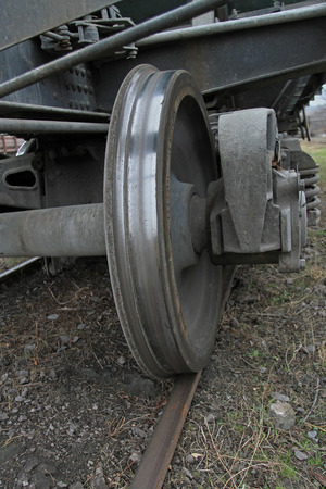 The wheel of the railway vehicle on rails close-up