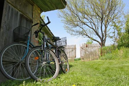 Two bikes in the spring on the farm yard Stock Photo