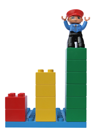 Statistical growth chart made up of cubes. Man on top of career