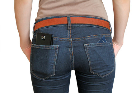 The girl in the back pocket of jeans smart phone and cards