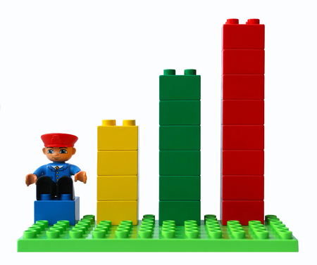 Statistical growth chart made up of blocks. The man at the beginning of career