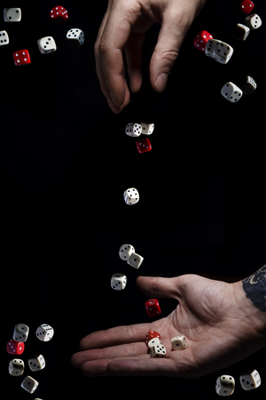 The hand throws dice, the hand catches dice, the concept of chance. Probability theory. Probability. Luck