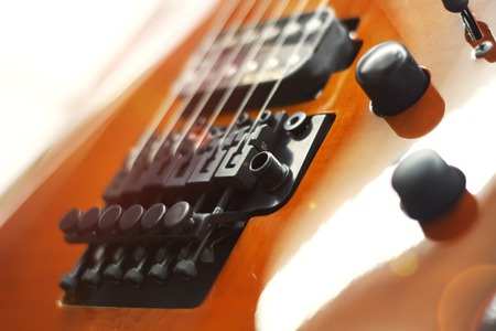 Electric guitar close-up with soft focus of brown color, Floyd Rose