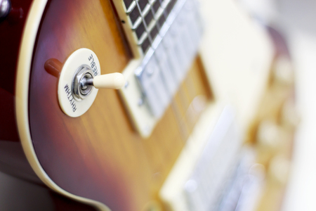 guitar close-up, potentiometers, volume controls on the guitar
