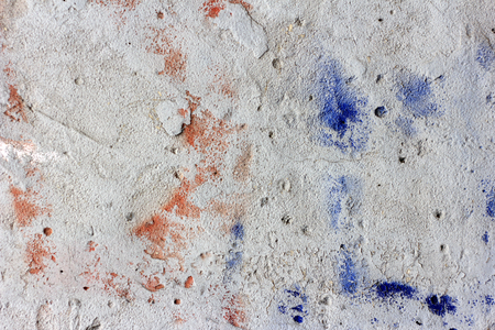 colorful spots of paint on a concete wall of an old air defence bunker