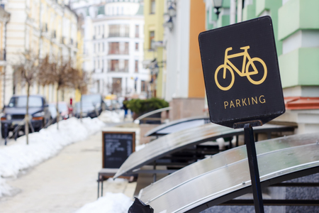 Badge parking for bicycles in the streets of the city. Close-up