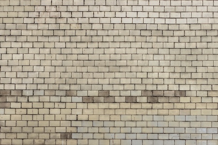 Old brick wall with white paint background texture close up. Stockfoto