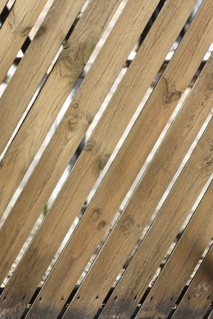 wooden fence with diagonal boards brown, pattern, surface Stockfoto