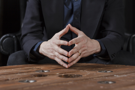 hands of a man in a suit, close-up