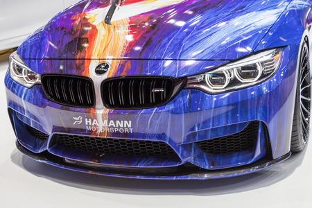 sportcar: Geneva, Switzerland - March 4, 2015: 2015 Hamann BMW M4 presented on the 85th International Geneva Motor Show