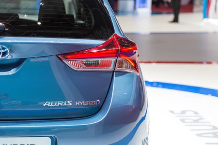motor de carro: Geneva, Switzerland - March 4, 2015: 2015 Toyota Auris Hybrid presented on the 85th International Geneva Motor Show