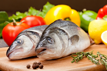 bass fish: Sea Bass with the vegetables  and lemon Stock Photo