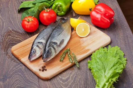 mediterranean cuisine: Sea Bass with the vegetables  and lemon Stock Photo