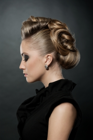 Blond woman with fashion hairstyle, eyes down
