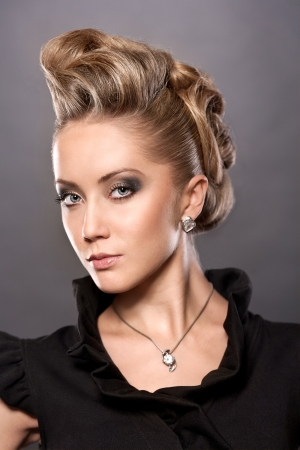 Portrait of  blond woman with fashion hairstyle photo