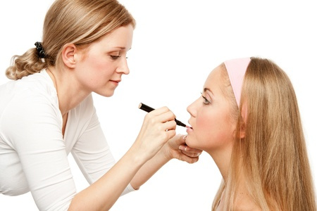 Beautician Applying Womans Make Up.Isolated on white photo