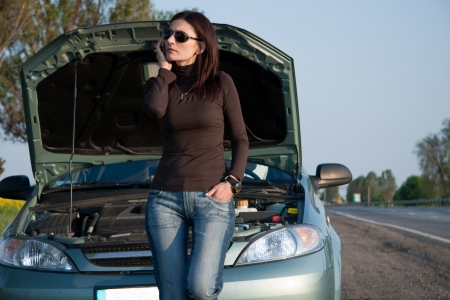 Worried Women Calling for Help With Her Car