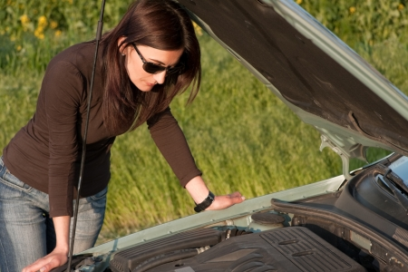 woman looking in the broken engine photo