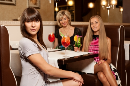 Girls with cocktails photo