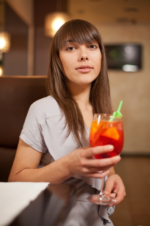 Young pretty girl with cocktail photo
