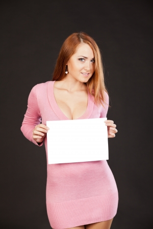 Young  beautiful woman is holding empty text board photo