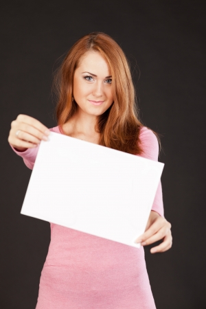 Young  beautiful woman is holding empty text board Stock Photo - 17384328