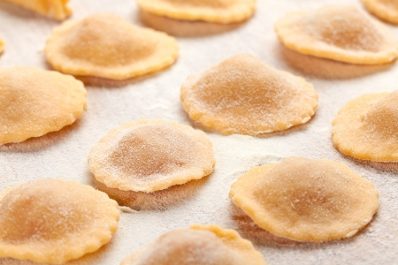 Ravioli with flour on wooden board Stock Photo - 17466331