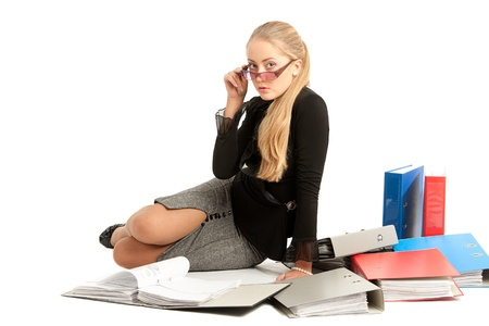 office physical pressure paper: accountant siting near to stack of files Stock Photo