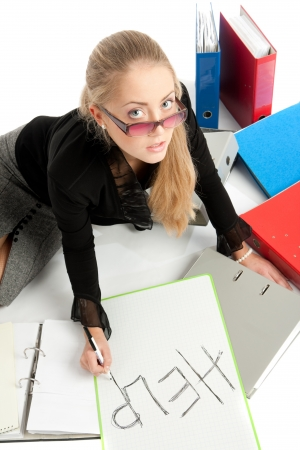 finance a helping hand confusion: accountant siting near to stack of files Stock Photo
