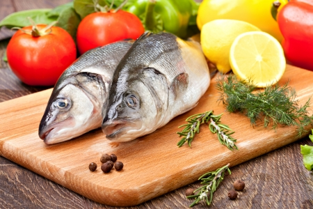 Sea Bass with the vegetables  and lemon Imagens