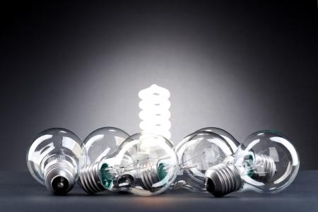 ahorro energia: L�mpara diferente. Concepto para la conservaci�n de la energ�a Foto de archivo
