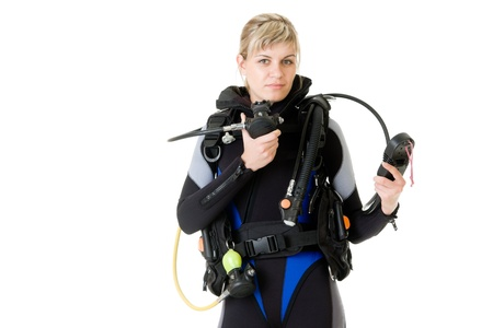wetsuit: diver cheking pressure by manometer before dive Stock Photo