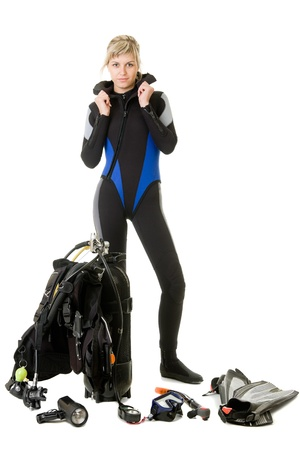 wetsuit: women checking her dive gear
