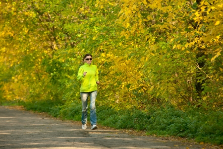 Moture woman jogging in autumn forest Stock Photo - 17757892