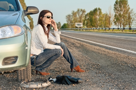 woman with damaged car calling for help Stock Photo - 18283585