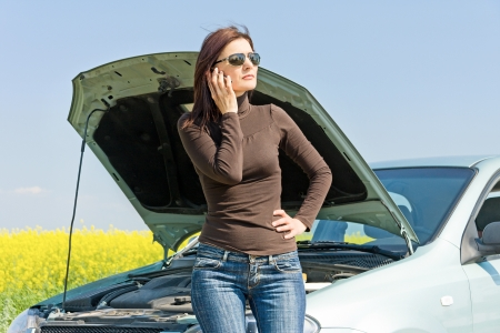 calling for help: Worried Women Calling for Help With Her Car