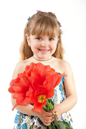 Adorable little girl  holding  bouquet of tulips   photo