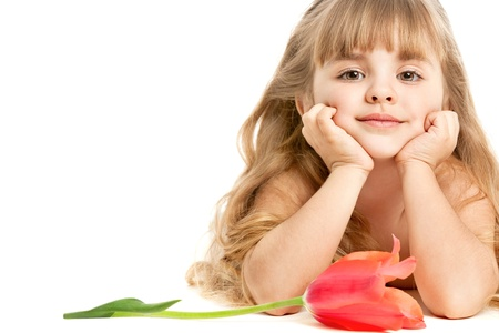 Adorable little girl  with a  tulip   With copy space  photo