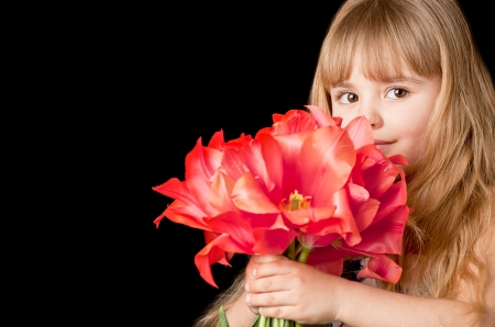 Adorable little girl  holding  bouquet of tulips   With copy space  photo