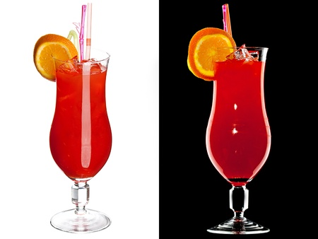 aperitive: A couple of identical alcoholic cocktails isolated  on  white and black