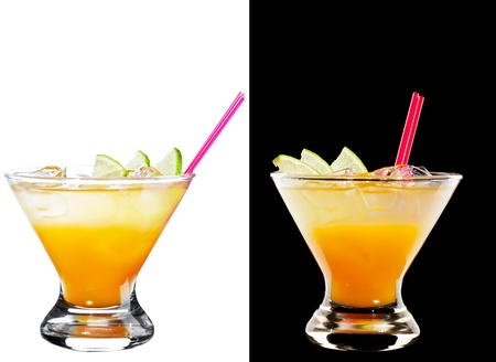 A couple of identical alcoholic cocktails isolated  on  white and black
