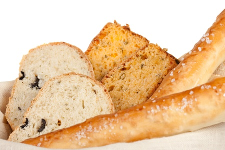 bread in basket isolated on white background  photo