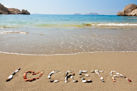I love Creta written in a sandy tropical beach photo