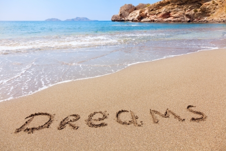 Dreams written in a sandy tropical beach photo