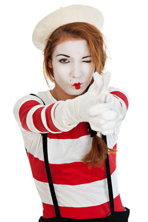 Portrait of the female MIM comedian doing gun hand gesture, isolated on white background photo