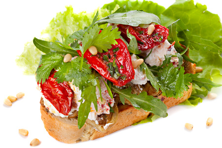 Fresh bruschetta with cheese and sun-dried tomatoes Stock Photo - 24479554