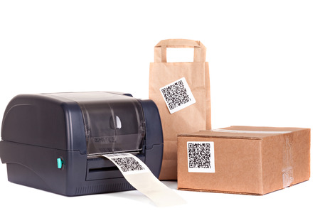 stocktaking:     barcode printer and packaging boxes marked with a bar code